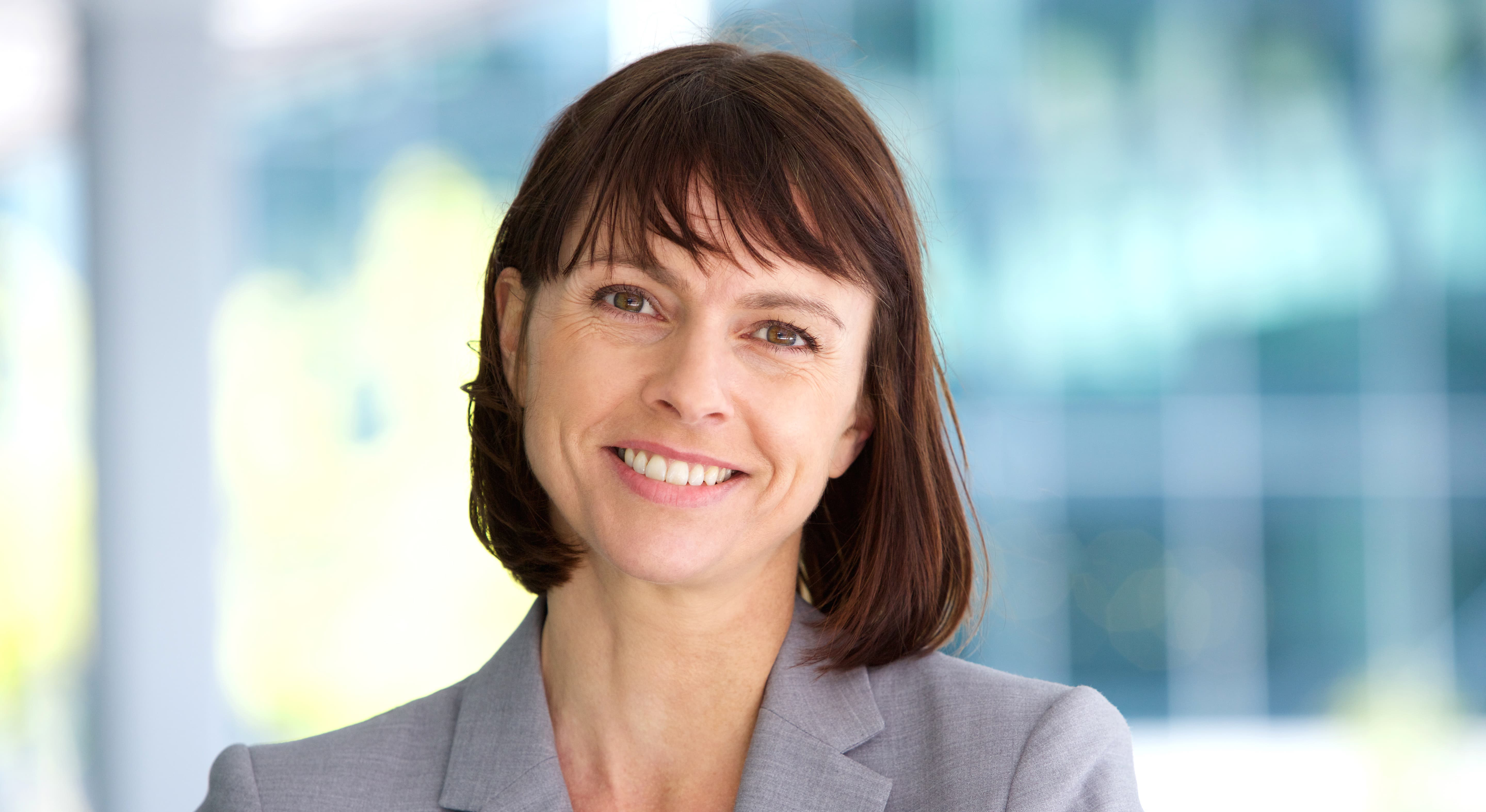 Corporate woman smiling to camera